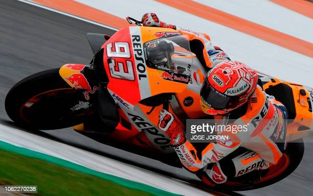 Repsol Honda's Spanish rider Marc Marquez rides during the first free practice session of the MotoGP Valencia Grand Prix at the Ricardo Tormo...