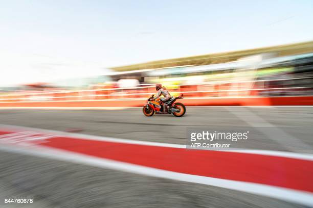TOPSHOT Repsol Honda's Spanish rider Marc Marquez rides his bike out of the pit during a free practice session of the San Marino Moto GP Grand Prix...