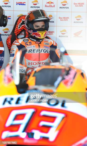 Repsol Honda's Spanish rider Marc Marquez sits in the box during the MotoGP fourth free practice of the Aragon Grand Prix at the Motorland racetrack...