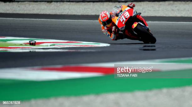 TOPSHOT Repsol Honda's Spanish rider Marc Marquez takes a curve during a free practice session ahead of the Italian MotoGP Grand Prix at the Mugello...