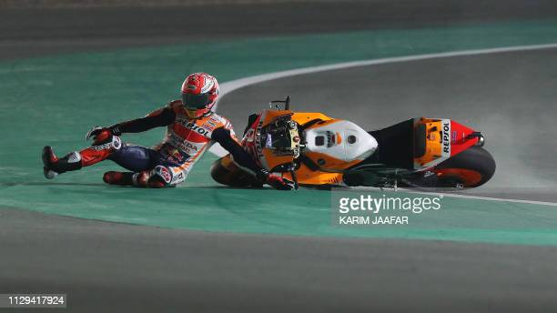 Repsol rider and current world champion Marc Marquez of Spain crashes in the fourth free practice session at Losail track near Doha on March 9, 2019...