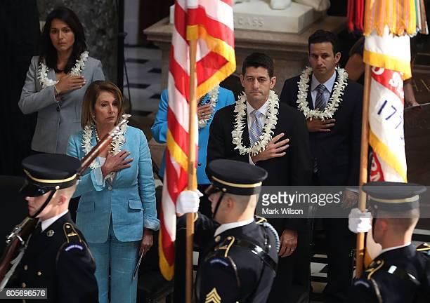 RepTulsi Gabbard House Minority Leader Nancy Pelosi House Speaker Paul Ryan and Rep Brian Schatz participate in a memorial service to honor the late...