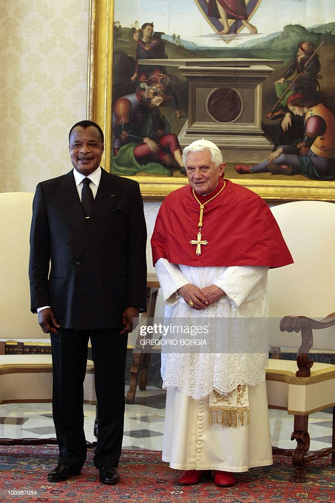 Republic of Congo President Denis Sassou Nguesso (L) poses with Pope Benedict XVI on May 24, 2010 during a private audience in the pontiff's private library at the Vatican.