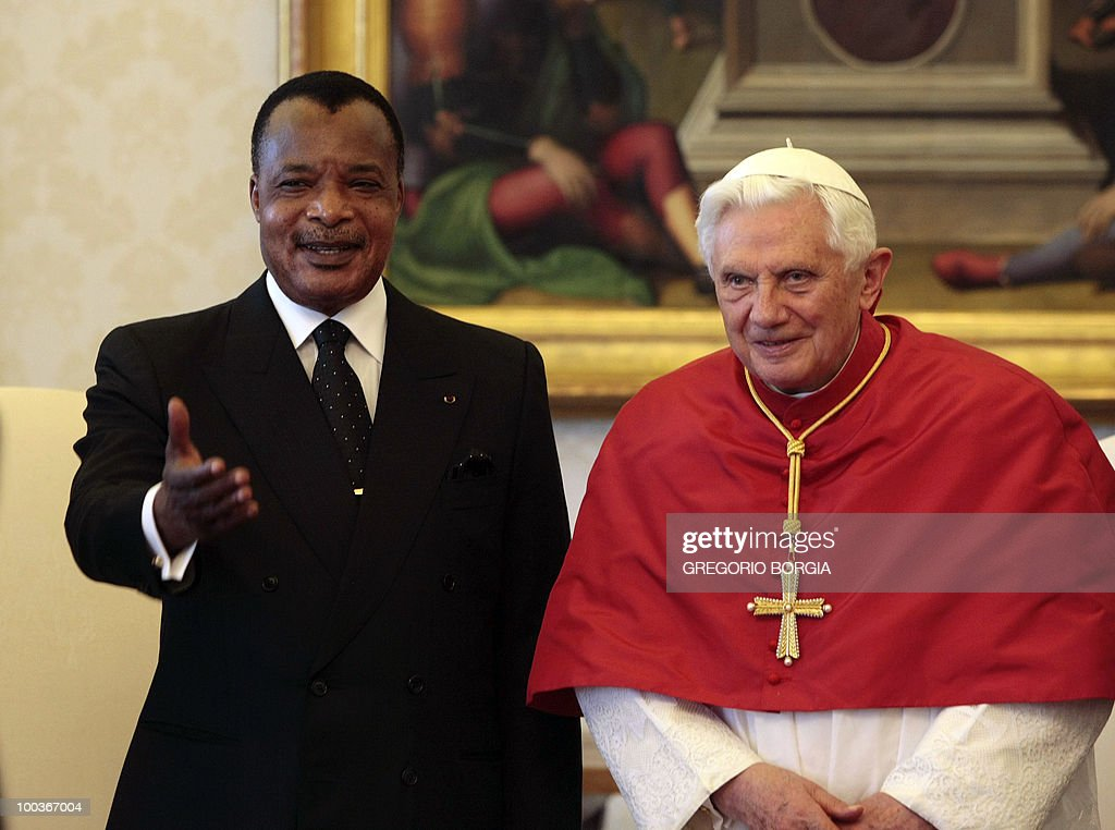 Republic of Congo President Denis Sassou Nguesso (L) presents his delegation to Pope Benedict XVIon May 24, 2010 during a private audience in the pontiff's private library at the Vatican.