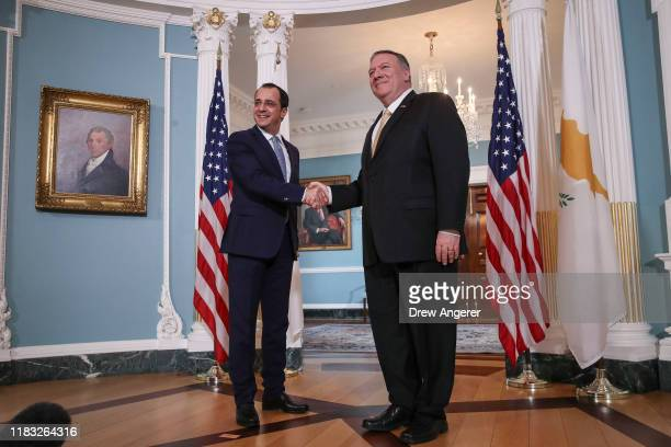 Republic of Cyprus Foreign Minister Nikos Christodoulides and U.S. Secretary of State Mike Pompeo shake hands during a brief photo opportunity before...