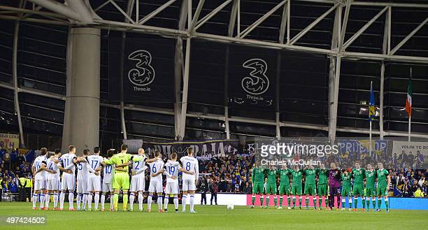 Republic of Ireland and BosniaHerzegovina players mark a moment of silence in rememberance of the Paris attacks before the Euro 2016 playoff second...