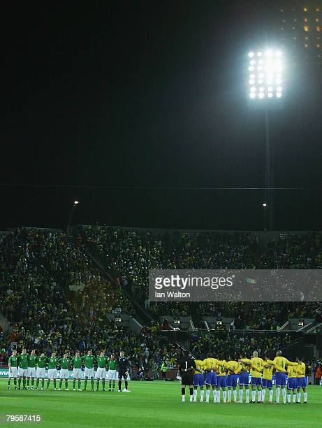 Republic of Ireland and Brazil players take part in a minute's silence to mark 50 years since the Munich Air Disaster when eight Manchester United...