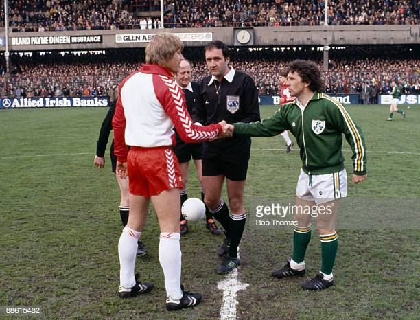 Republic of Ireland captain Johnny Giles meets Denmark's Per Rontved watched by French referee Michel Vautrot prior to their European Championship...