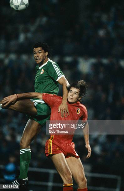 Republic of Ireland defender Paul McGrath outjumps Belgium's Georges Grun during their European Championship Qualifying match at the Heysel Stadum in...