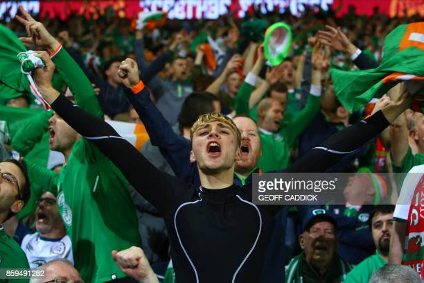TOPSHOT Republic of Ireland fans celebrate victory after the group D World Cup qualifying football match between Wales and Republic of Ireland at...