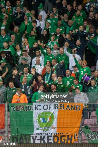 Republic of Ireland fans give voice during the UEFA Euro 2020 qualifier between Switzerland and Republic of Ireland on October 15 2019 in Geneva...