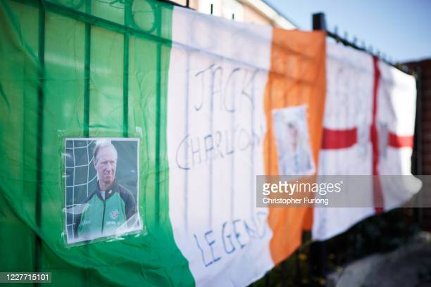 Republic of Ireland flag is displayed amongst other Jack Charlton tributes ahead of the funeral cortege which is due to pass through his childhood...