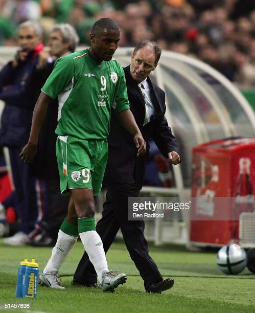 Republic of Ireland manager Brian Kerr talks to Clinton Morrison as he limps off the pitch during the Group 4 2006 World Cup Qualifying match between...