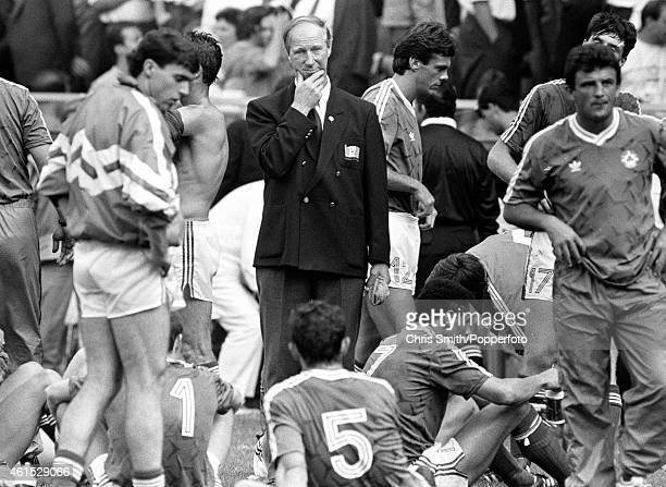 Republic of Ireland manager Jack Charlton looks thoughtful as he stands with his players prior to extratime in the FIFA World Cup match between the...