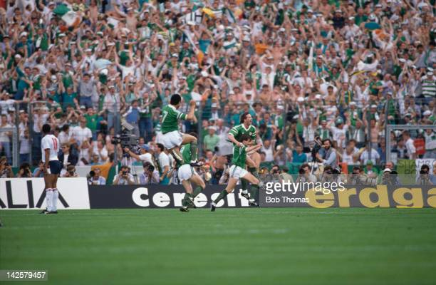 Republic of Ireland players celebrate Ray Houghton's goal during the European Championship at Stuttgart, 12th June 1988. The score was England 0,...