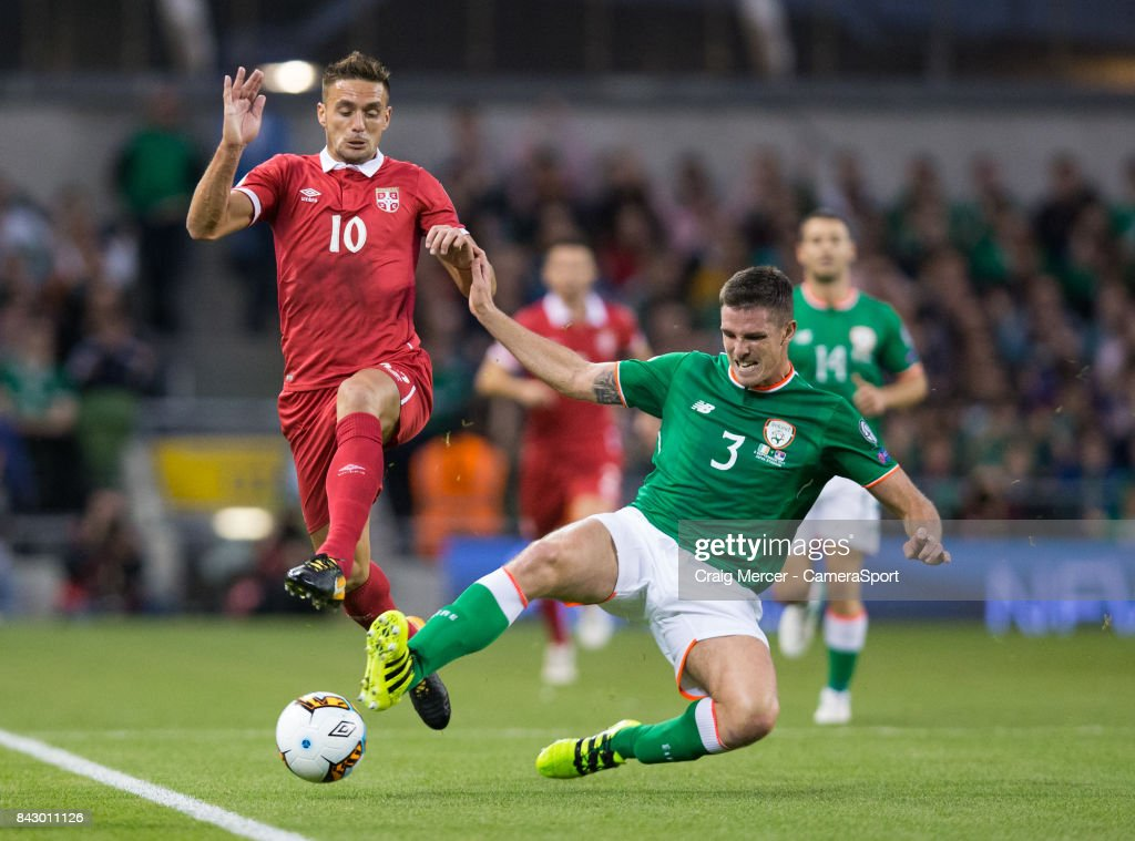 Republic of Ireland's Ciaran Clark vies for possession with Serbias Dusan Tadic during the FIFA 2018 World Cup Qualifier between Republic of Ireland and Serbia at Aviva Stadium on September 5, 2017 in Dublin, .