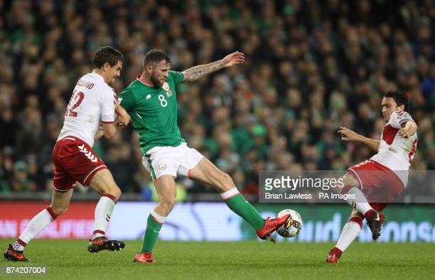 Republic of Ireland's Daryl Murphy and Denmark's Andreas Bjelland and Thomas Delaney battle for the ball during the 2018 FIFA World Cup qualifying...