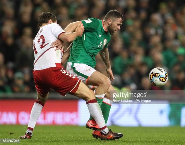 Republic of Ireland's Daryl Murphy and Denmark's Andreas Bjelland battle for the ball during the 2018 FIFA World Cup qualifying playoff second leg...