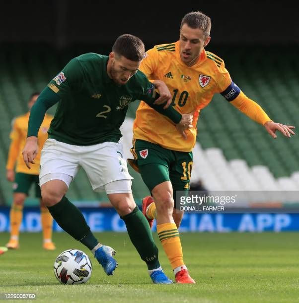Republic of Ireland's defender Matt Doherty vies with Wales' midfielder Aaron Ramsey during the UEFA Nations League Group B4 football match between...