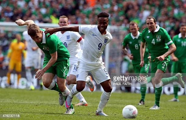 Republic of Ireland's defender Seamus Coleman vies with England's midfielder Raheem Sterling during the international friendly football match between...