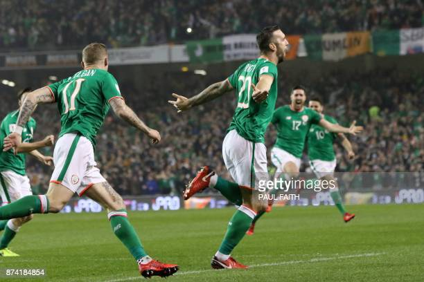 Republic of Ireland's defender Shane Duffy celebrates with teammates after scoring the opening goal of the FIFA World Cup 2018 qualifying football...