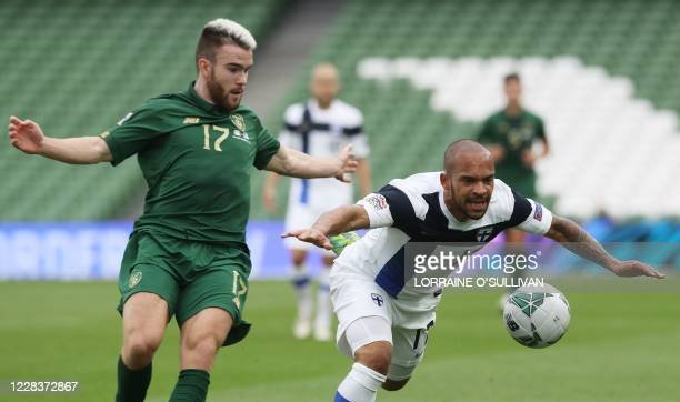 Republic of Ireland's forward Aaron Connolly challenges Finland's defender Nikolai Alho during the UEFA Nations League football match between the...