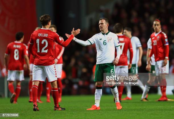 Republic of Ireland's Glenn Whelan and Denmark's Andreas Bjelland during the FIFA World Cup qualifying playoff first leg match at the Parken Stadium...