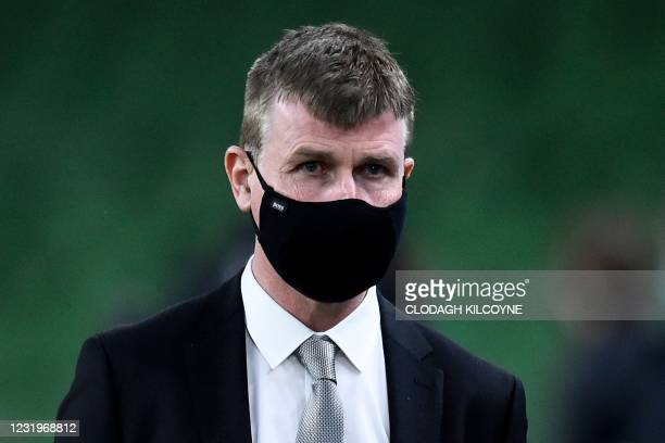 Republic of Ireland's head coach Stephen Kenny wearing a face covering due to Covid-19, walks on the pitch ahead of the FIFA World Cup Qatar 2022...