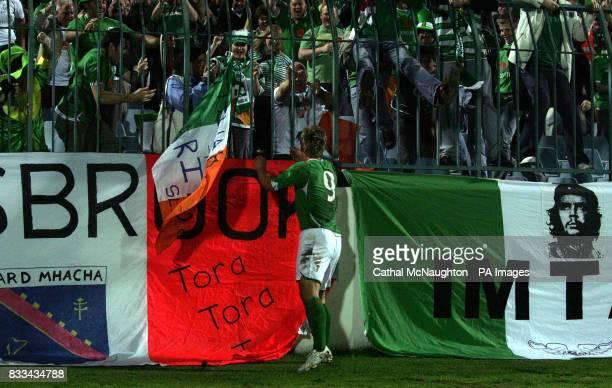 Republic of Ireland's Kevin Doyle celebrates scoring with fans during the UEFA European Championship Qualifying match at Slovan Stadium Bratislava...