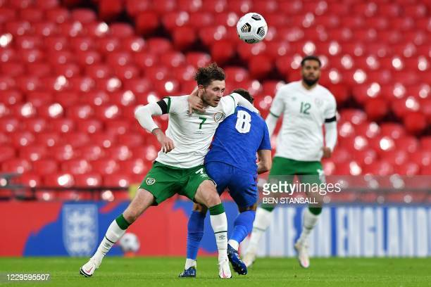 Republic of Ireland's midfielder Alan Browne and England's midfielder Harry Winks vie for the ball during the international friendly football match...