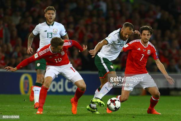Republic of Ireland's midfielder David Meyler vies with Wales' midfielder Aaron Ramsey and Wales' midfielder Joe Allen during the group D World Cup...