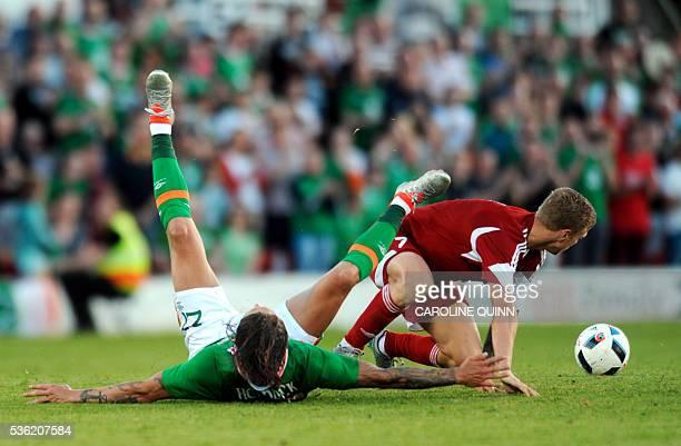 Republic of Ireland's midfielder Jeff Hendrick vies with Belarus's midfielder Nikita Korzun during the international friendly football match between...