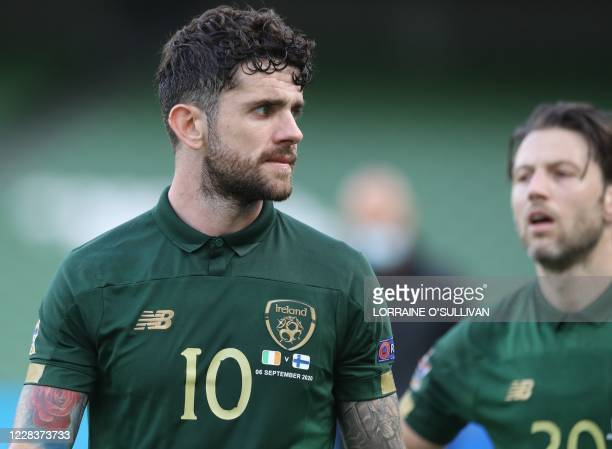 Republic of Ireland's midfielder Robbie Brady and Republic of Ireland's midfielder Harry Arter leave the field after losing 0-1 in the UEFA Nations...
