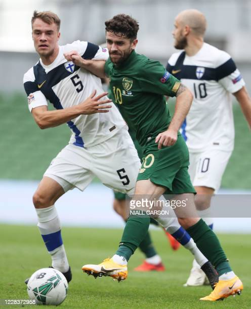 Republic of Ireland's midfielder Robbie Brady is challenged by Finland's defender Leo Vaisanen during the UEFA Nations League football match between...