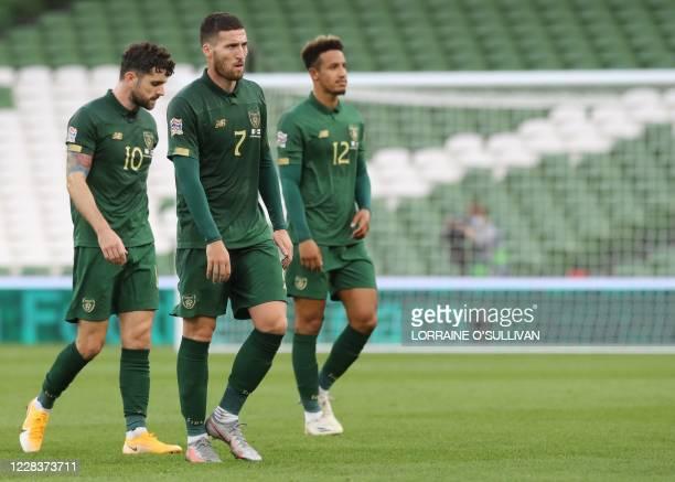 Republic of Ireland's midfielder Robbie Brady , Republic of Ireland's defender Matt Doherty and Republic of Ireland's forward Callum Robinson leave...