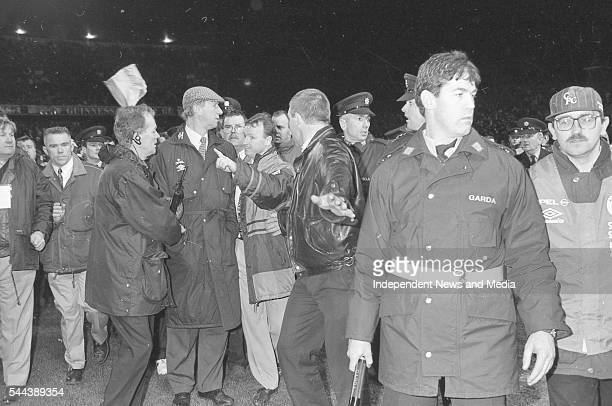 Republic of Ireland's soccer team manager Jack Charlton is escorted off the field after a match between ROI and England at Lansdowne Road Dublin...