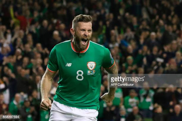 Republic of Ireland's striker Daryl Murphy celebrates scoring the opening goal during the FIFA World Cup 2018 qualification football match between...
