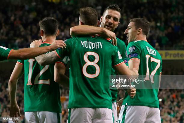Republic of Ireland's striker Daryl Murphy celebrates scoring their second goal during the FIFA World Cup 2018 qualification football match between...