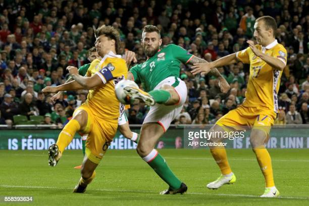 Republic of Ireland's striker Daryl Murphy scores the opening goal during the FIFA World Cup 2018 qualification football match between Republic of...