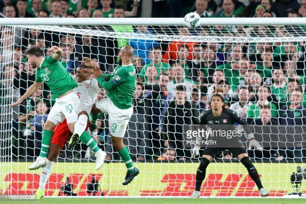 Republic of Ireland's striker David McGoldrick climbs to head home the Irish equalizer during the Euro 2020 football qualification match between...