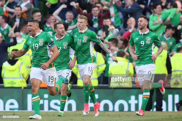 Republic of Ireland's striker Jonathan Walters celebrates with teammates after scoring their equalizer during the group D World Cup qualifying...