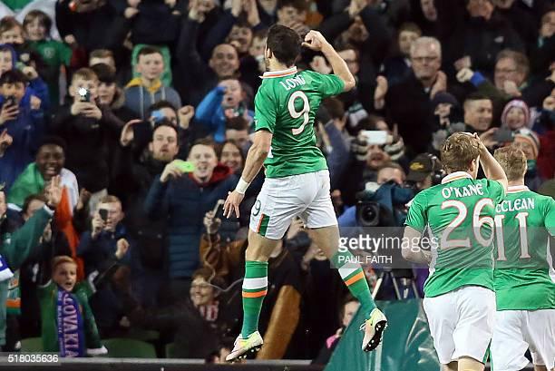 Republic of Ireland's striker Shane Long celebrates scoring an equalising goal for 11 during the international friendly football match between...