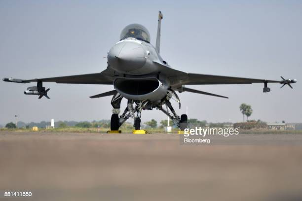 A Republic of Singapore Air Force F16 fighter jet developed by Lockheed Martin Corp sit on the tarmac at the Kalaikunda Air Force Station West Bengal...