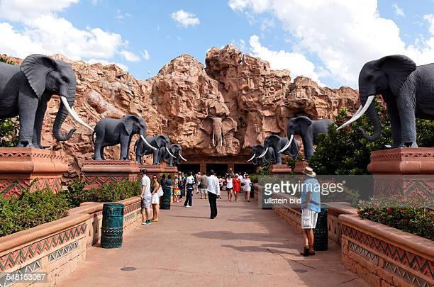 Republic of South Africa North West Transvaal Sun City Sculptures of elephants lined up a street in the background a rock with animal sculpzures