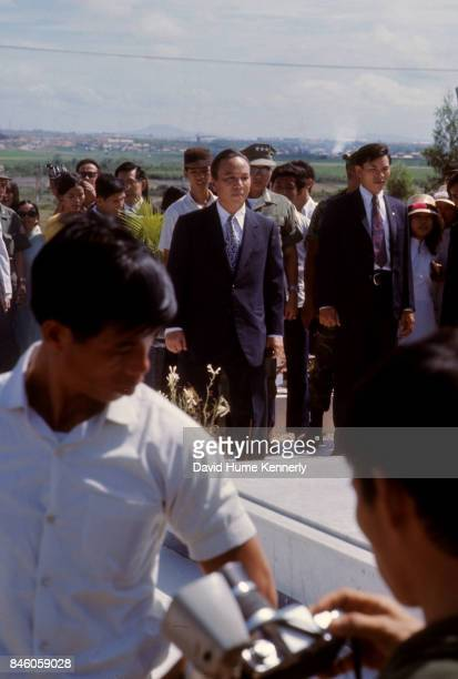 Republic of Vietnam President Nguyen Van Thieu stands with others at a grave in the National Military Cemetery Thu Duc South Vietnam 1973