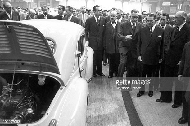 Republic president Rene COTY Andre LE TROQUER et Jacques CHABANDELMAS watching a 4 CV by RENAULT at Paris Car Show