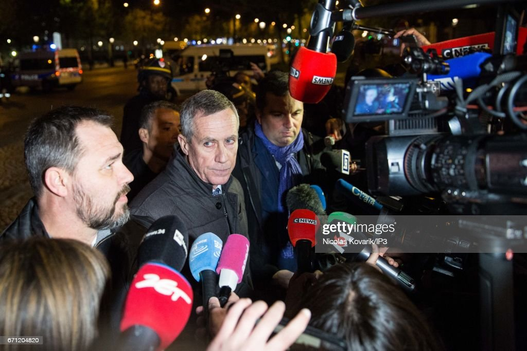 Republic Prosecutor Francois Molins (C) and Interior Ministry spokesman Pierre Henry Brandet (R) speaks to the press after a suspected terrorist attack on April 20, 2017 in Paris, France. One police officer was killed and another wounded in a shooting on Paris's Champs Elysees, police said just days ahead of France's presidential election. France's interior ministry said the attacker was killed in the incident on the world famous boulevard that is popular with tourists.