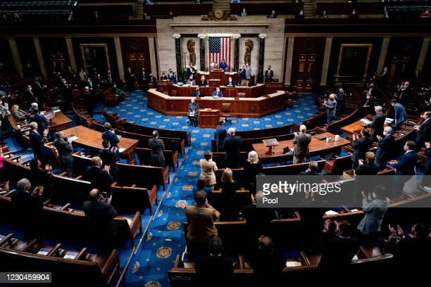 Republican and Democrats clap as House Minority Leader Kevin McCarthy commends Capitol Police and law enforcement for their work after Pro-Trump...