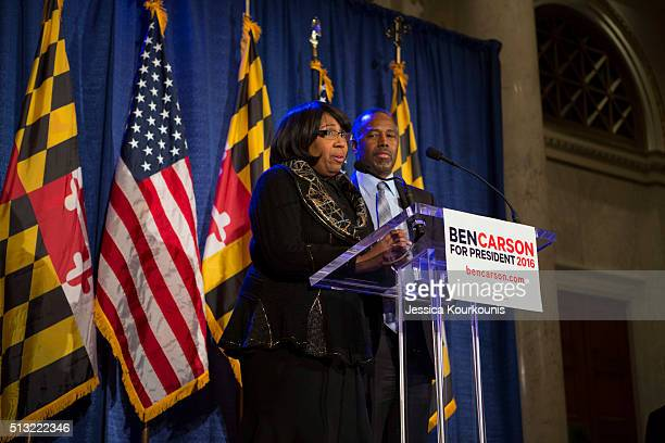 Republican candidate Dr Ben Carson right and his wife Candy Carson left speak to supporters at his campaign at his Super Tuesday election party at...