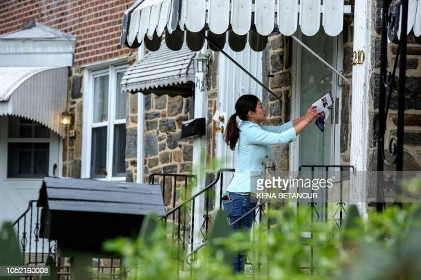 Republican candidate for Congress Pearl Kim distributes flyers as she campaigns in Upper Darby Pennsylvania on October 14 2018 Kim is the daughter of...